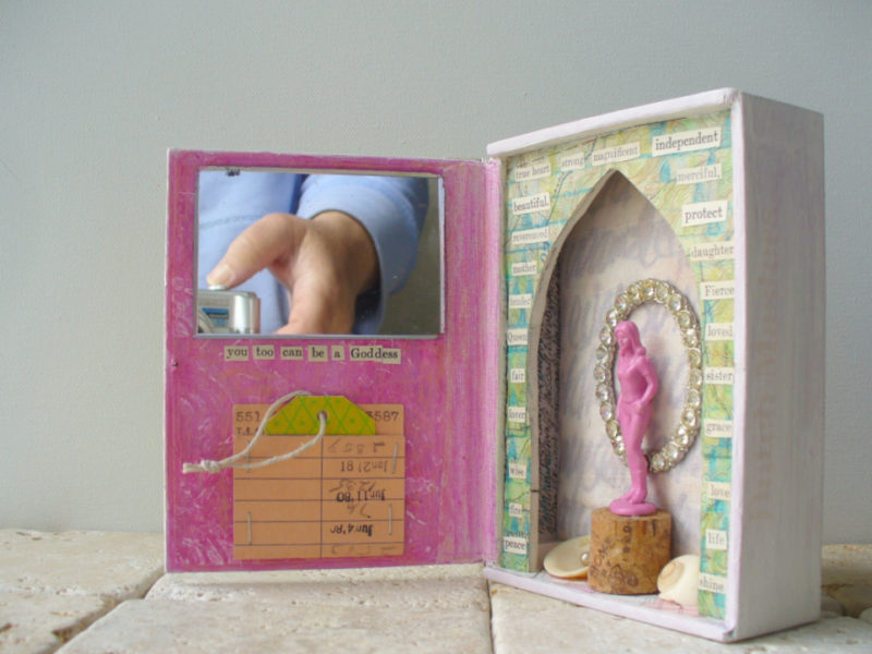 3d assemblage art piece with mirror shells rhinestones pink plastic toy vintage library card