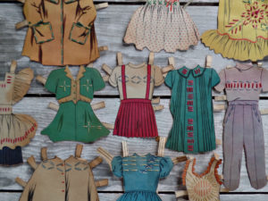vintage paper doll clothes with embroidered stitches