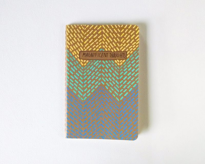magnificent thoughts notebook handpainted in yellow, aqua and blue by messy bed studio