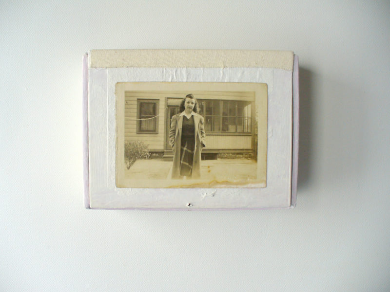 closed goddess shrine in white paint and vintage photo of woman in front of a house
