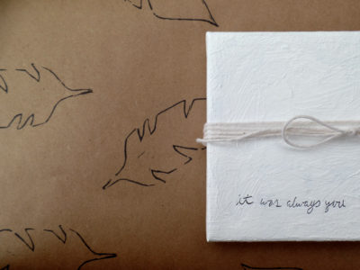 feathers gift wrap by messy bed studio