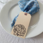 place setting with peony wedding tag by messy bed studio