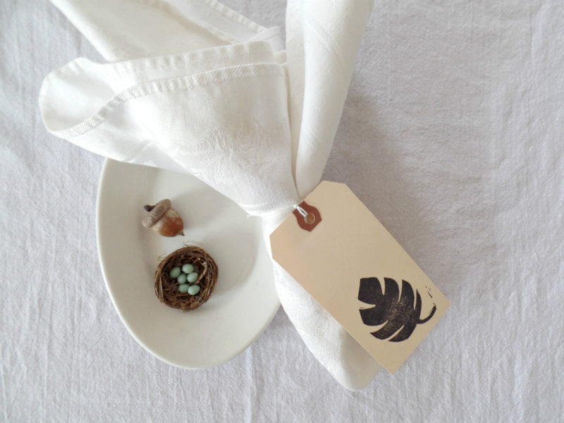 monstera leaf wedding place card by messy bed studio