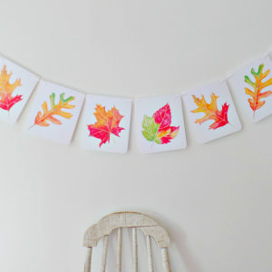 watercolor painted autumn leaves holiday banner to decorate your home