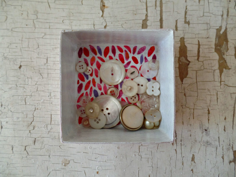 inside of girl power box with vintage buttons