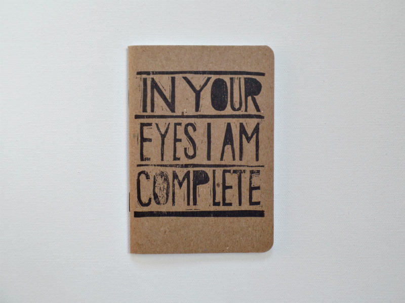 in your eyes i am complete notebook hand printed with black ink