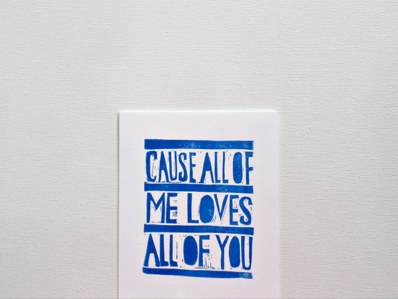 all of me loves all of you close up of card