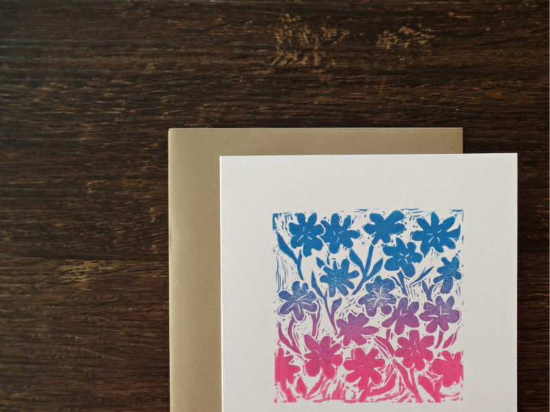 close up of hand printed floral card and envelope