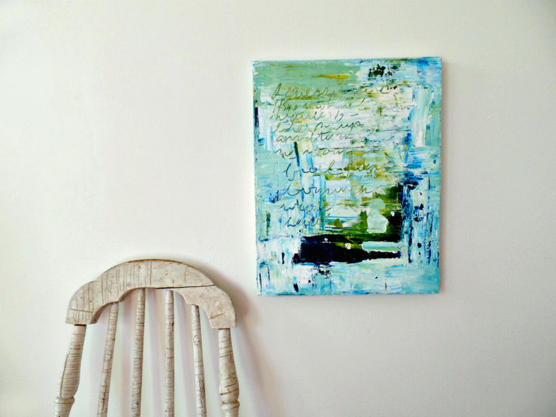 abstract painting on wall next to chair