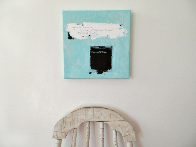 original abstract art on wall with chair