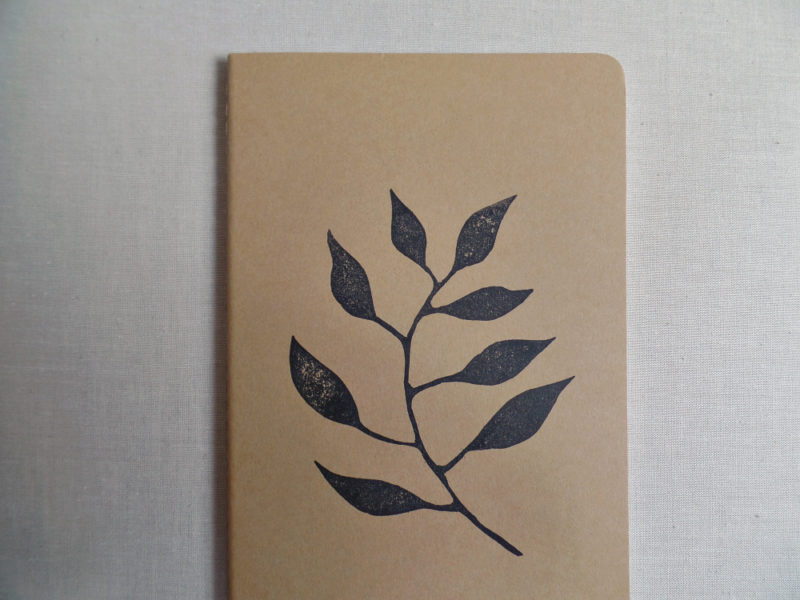garden journal with botanical design on moleskine notebook