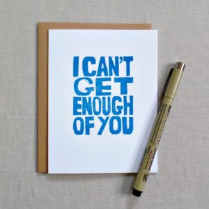 greeting card with envelope that says i can't get enough of you with pen