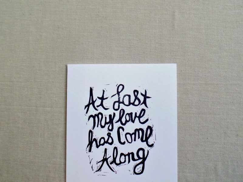 close up of hand printed card with Etta James lyrics