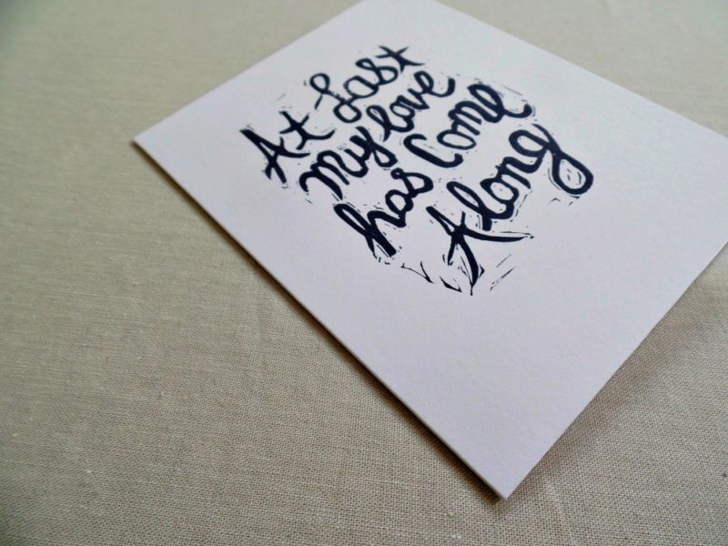 side view of card with At Last song lyrics