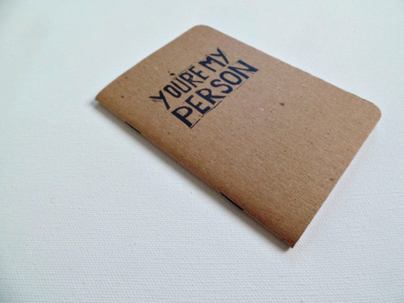 side view of hand printed notebook with quote from grey's anatomy