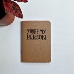 grey's anatomy you're my person quote printed on a notebook