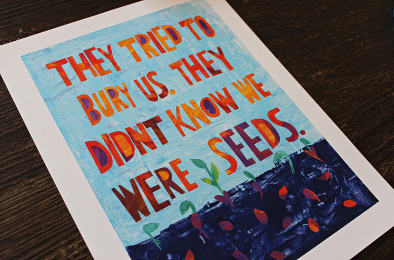 closeup of art print with they tried to bury us quote