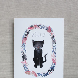 closeup of blank note card with black cat and flowers