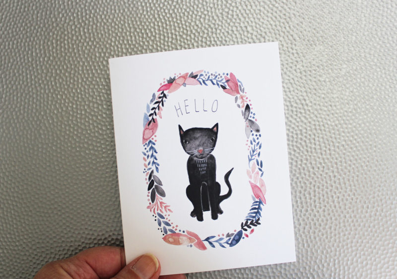 hello blank notecard with black cat in hand