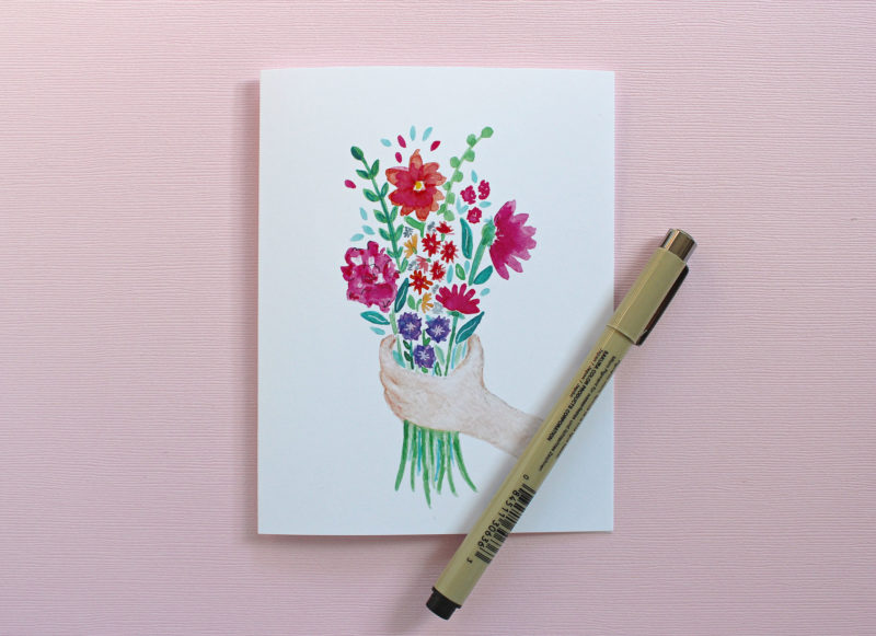 blank thinking of you card with pen on pink background