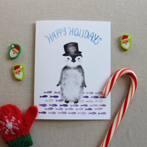 penguin happy holidays card with christmas decorations