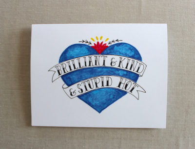 brilliant and kind card in blue painted old school tattoo heart