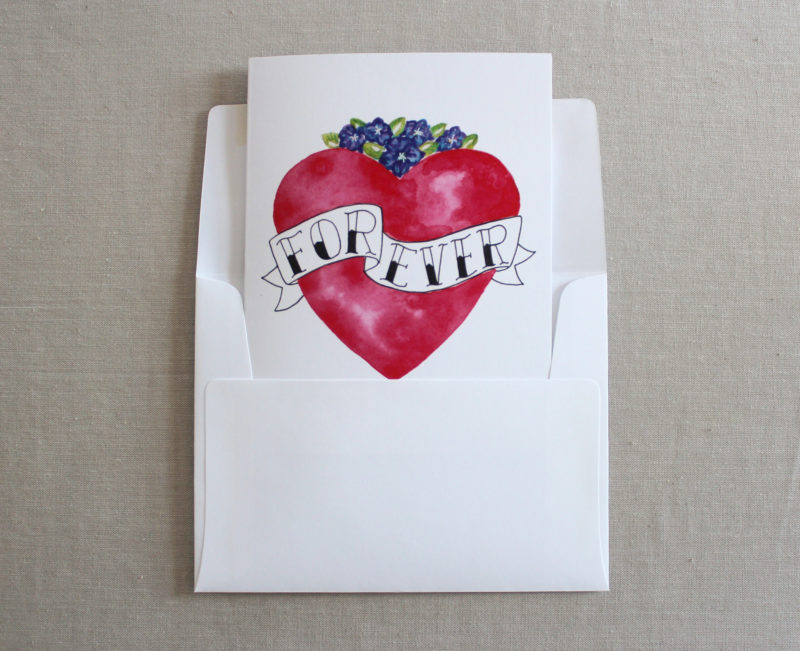 i love you card with heart and forever text in envelope
