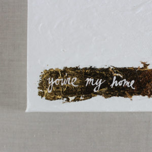 close up of white and gold leaf painting with you're my home