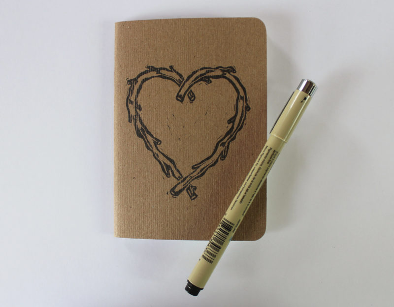 small notebook with hand printed heart