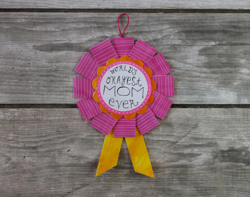world's okayest mom award in pink and orange