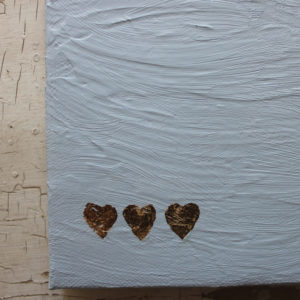 detail of love notes for him mixed media painting with 3 gold leaf hearts