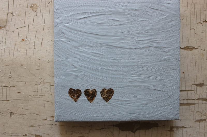 detail of texture and hearts on love notes for him painting by messy bed studio