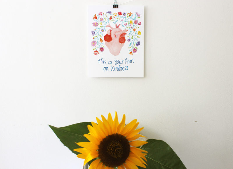 anatomical heart with flowers art print hanging above a sunflower
