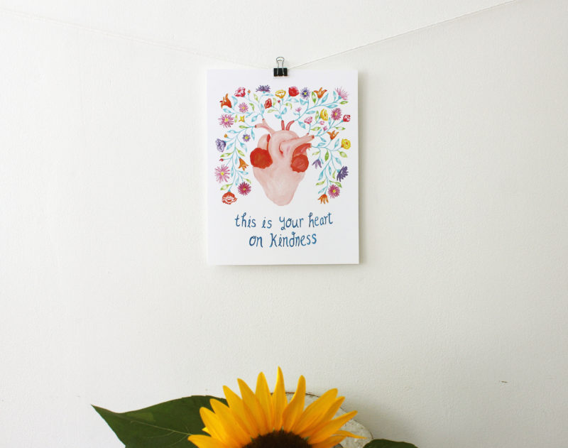 this is your heart on kindness inspirational print hanging above a sunflower