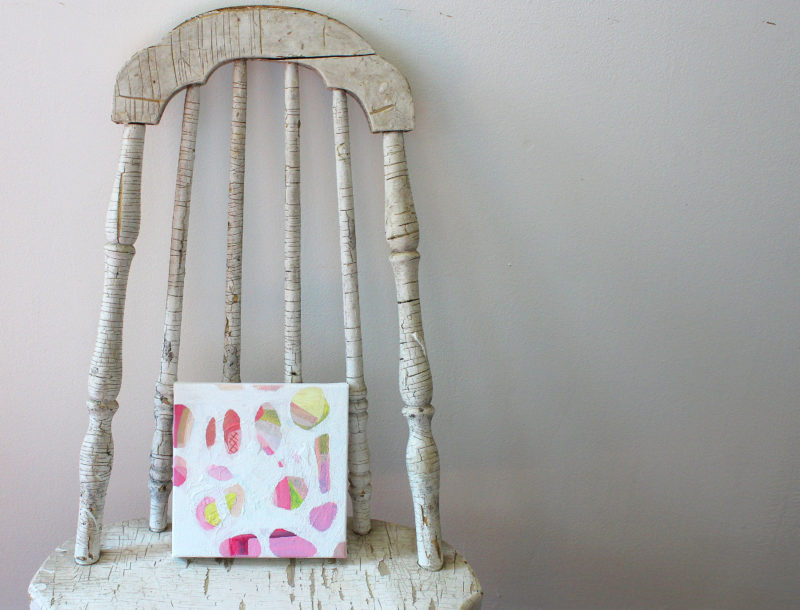 small square abstract painting on chair