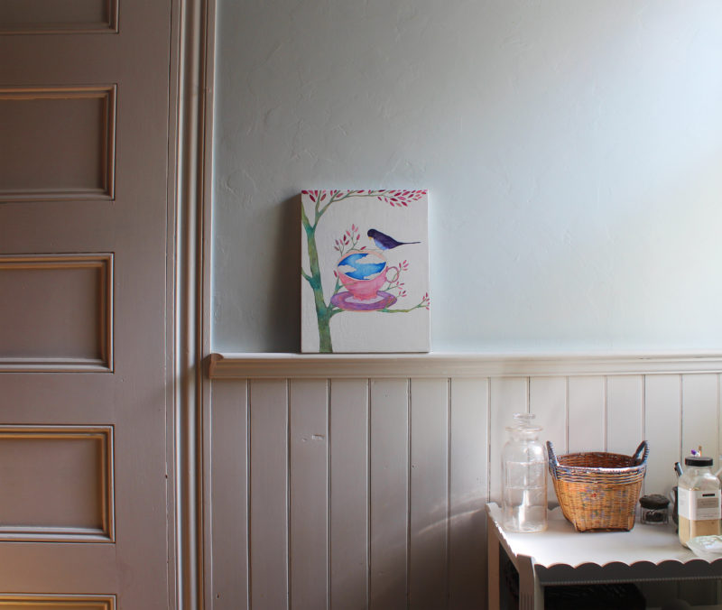 bird and teacup painting on wall ledge