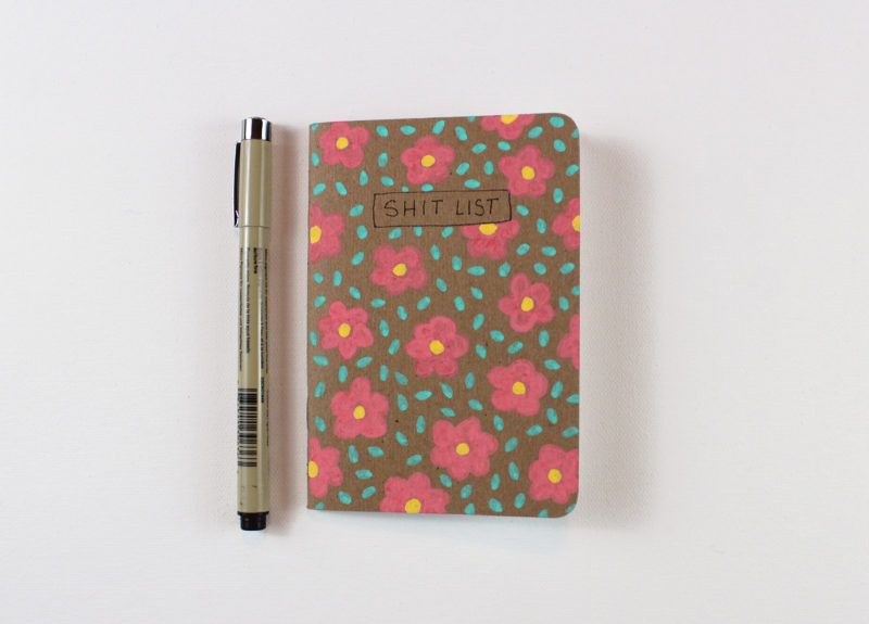Shit list notebook with flowers and pen