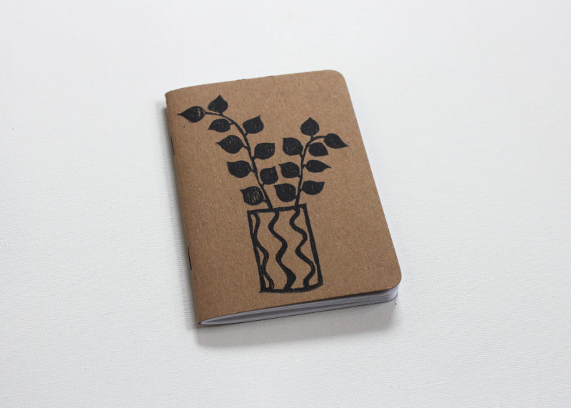 hand printed journal of a plant in a pot