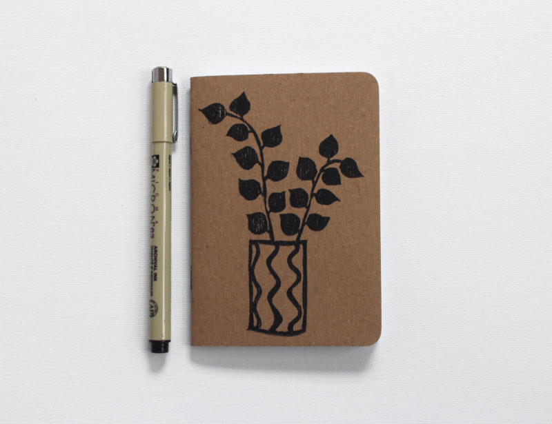 plants in pots hand printed small notebook and pen