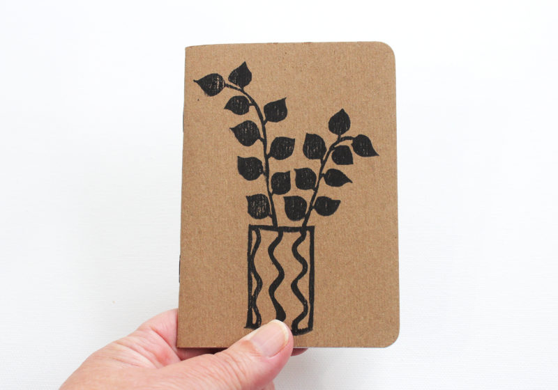 hand holding a cute botanical notebook