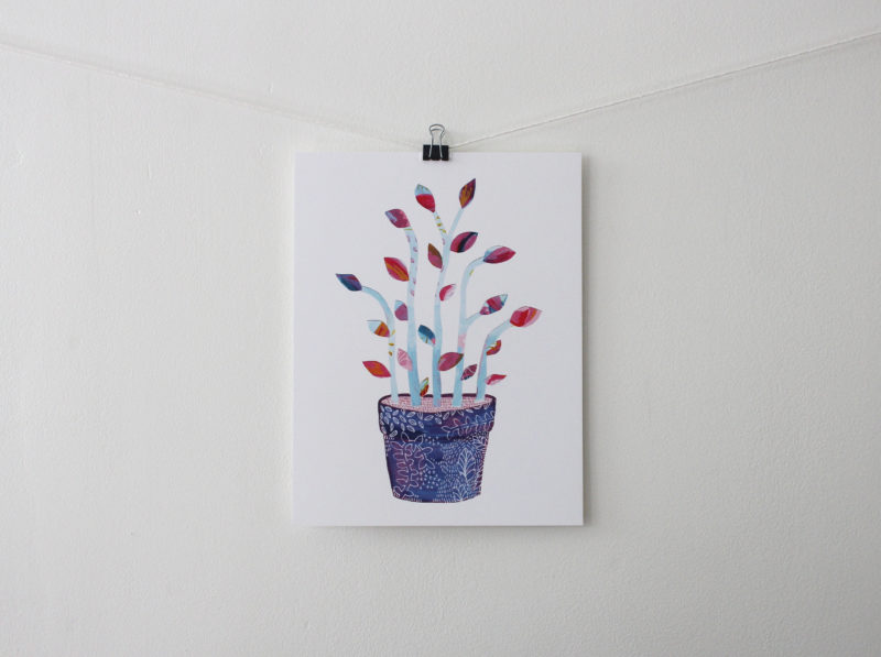 botanical art prints hanging on a white wall