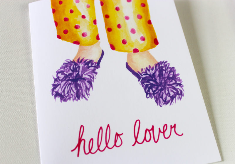 close up of funny love card with the words hello lover in pink and watercolor image of purple fuzzy slippers and polka dot pjs