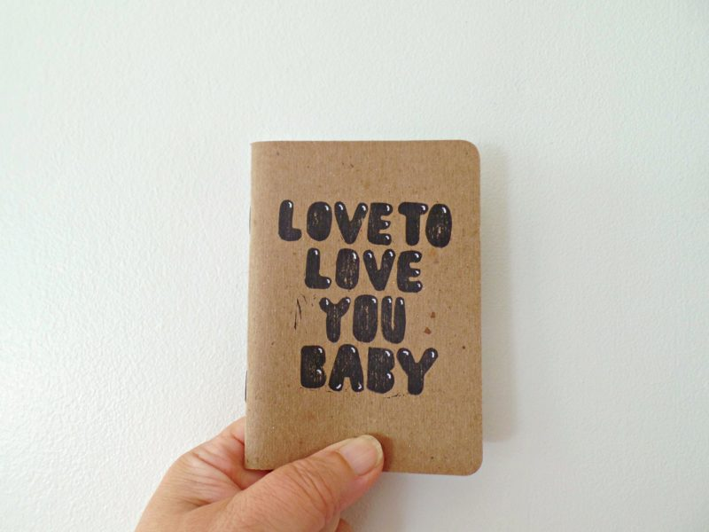 love to love you baby notebook held in hand