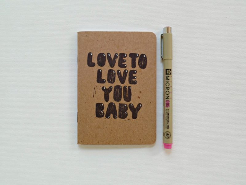 Love to love you baby notebook shown with a pen