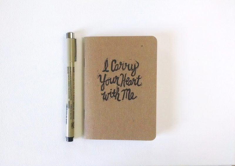 I Carry Your Heart Notebook hand printed in black ink shown with pen by messy bed studio