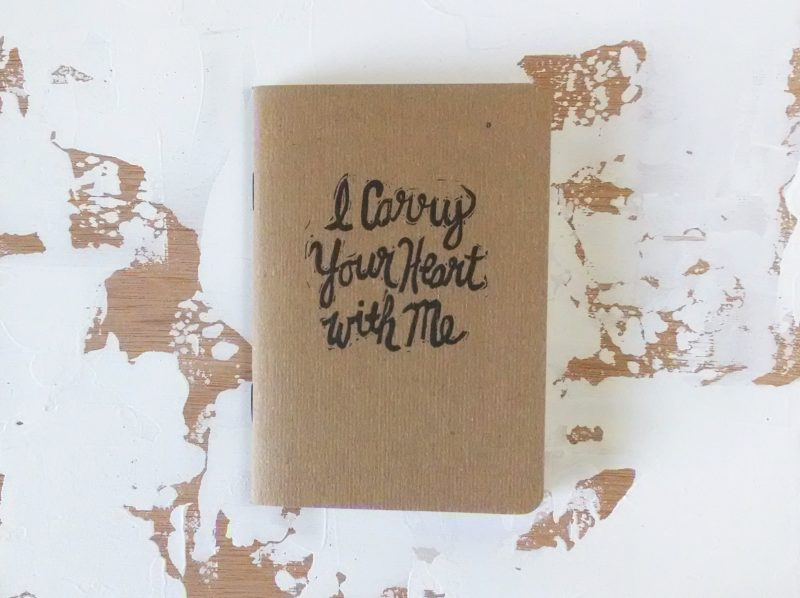 I carry your heart hand printed in black ink notebook by messy bed studio