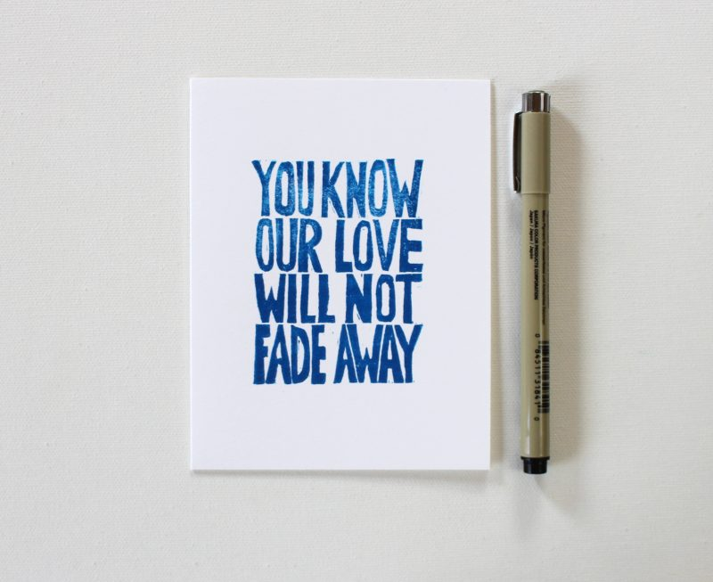 you know our love will not fade away cards in blue ink on white card shown with a pen by messy bed studio