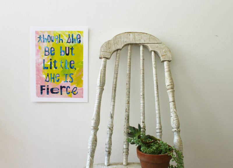 though she be but little she is fierce wall art hanging on a wall next to a vintage chair with a succulent plant on it by messy bed studio