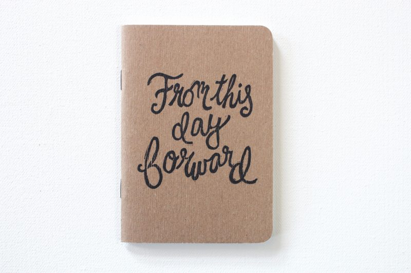 one of a pair of hand printed vow books with the words from the day forward by messy bed studio