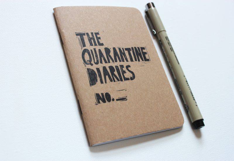 quarantine journal with the words the quarantine diaries hand printed in black ink by messy bed studio